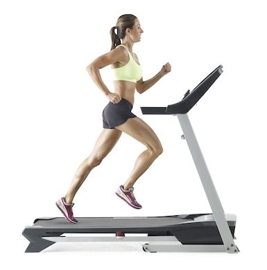 A young girl running on proform zt4 treadmill