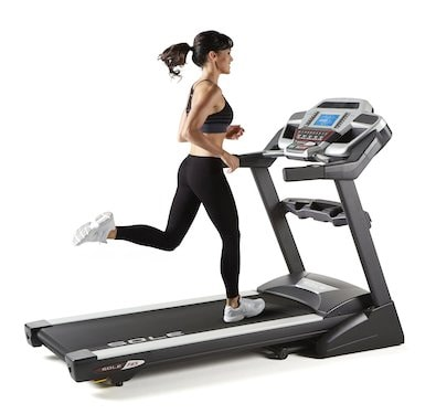In this photo a girl running on sole f65 treadmill