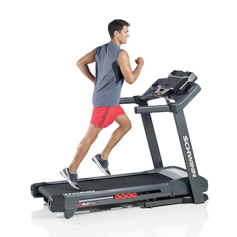 A young men running on Schwinn 830 Treadmill