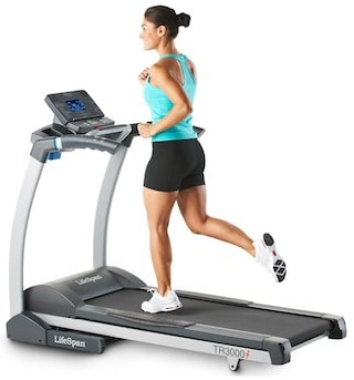 A girl running on LifeSpan TR 3000i Treadmill